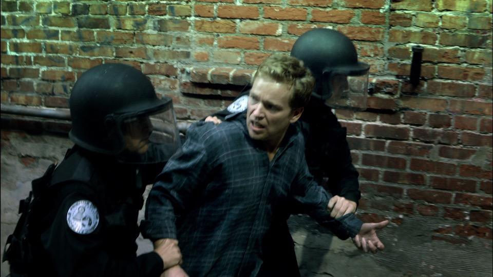 Nick Brady (Jonathan Scarfe) apprehended by alternate- American fascist police Guards, Radio Free Albemuth